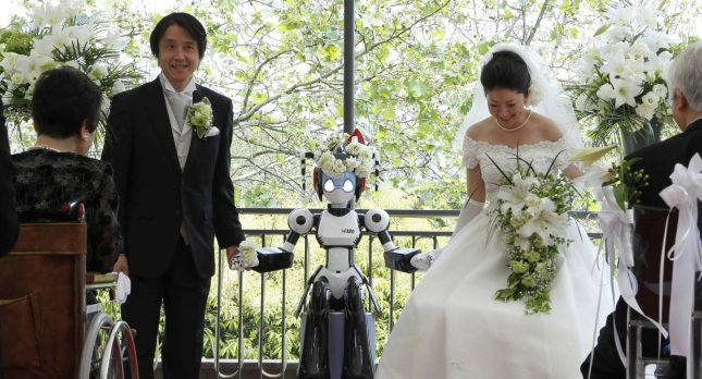 A robot minister performs a wedding ceremony in Japan in 2010.